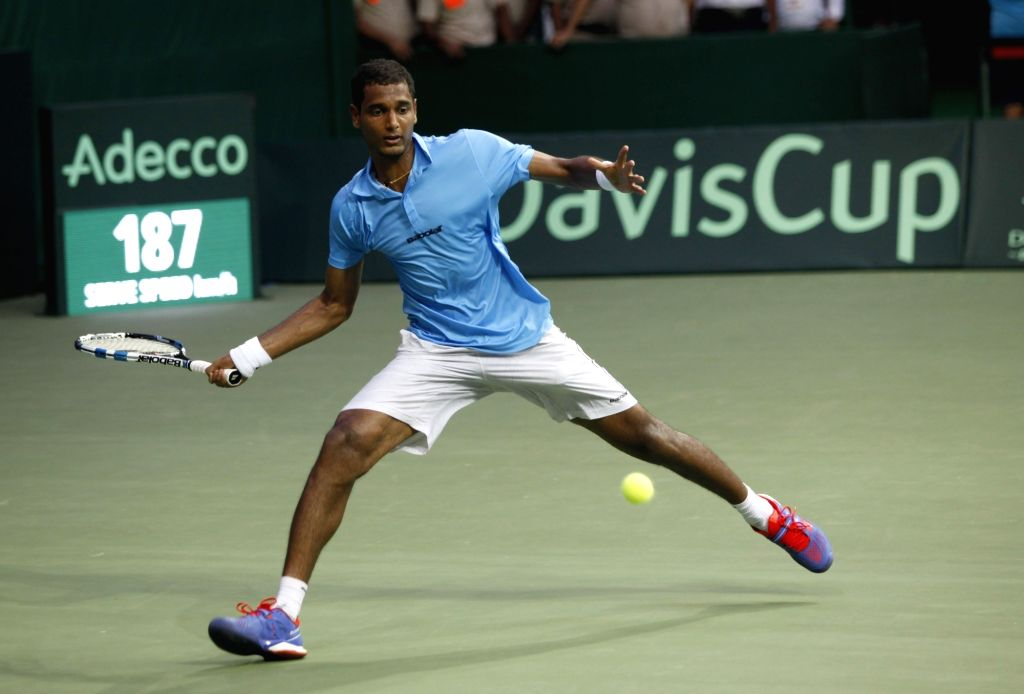 Indian tennis player Ramkumar Ramanathan in action against Spain's Feliciano Lopez during Davis Cup World Group playoff match between Indian and Spain at the Delhi Lawn Tennis Association ...