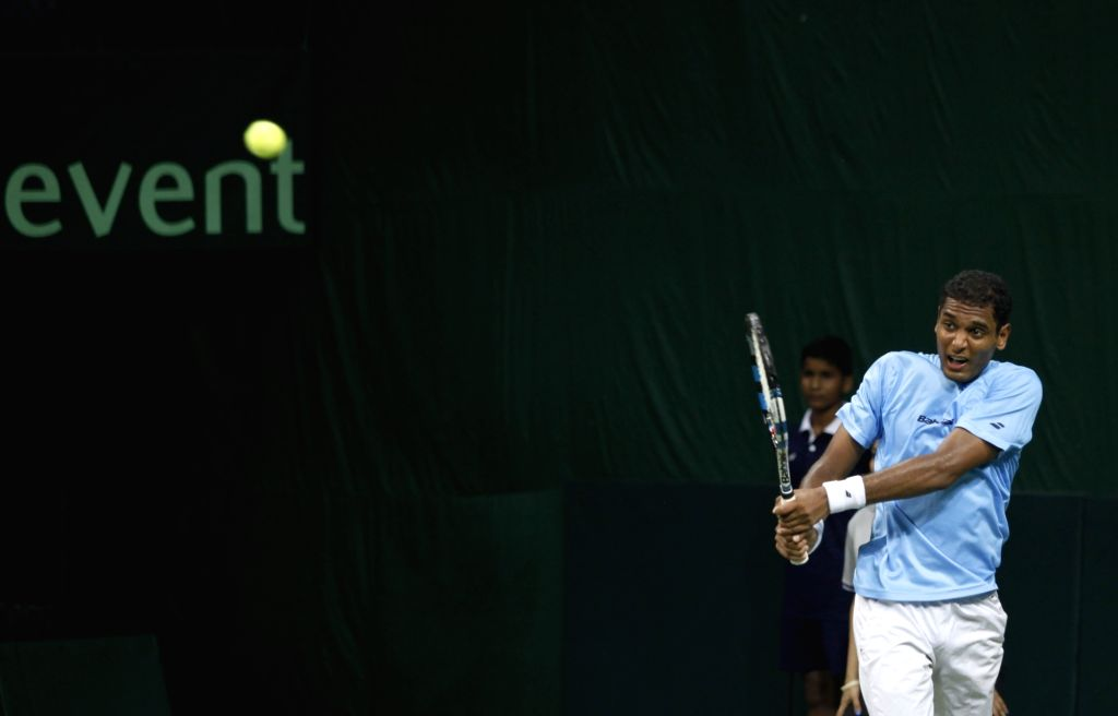 Indian tennis player Ramkumar Ramanathan in action against Spain's Feliciano Lopez during Davis Cup World Group Play-off at RK Khanna Tennis Stadium in New Delhi on Sept 16, 2016. ...