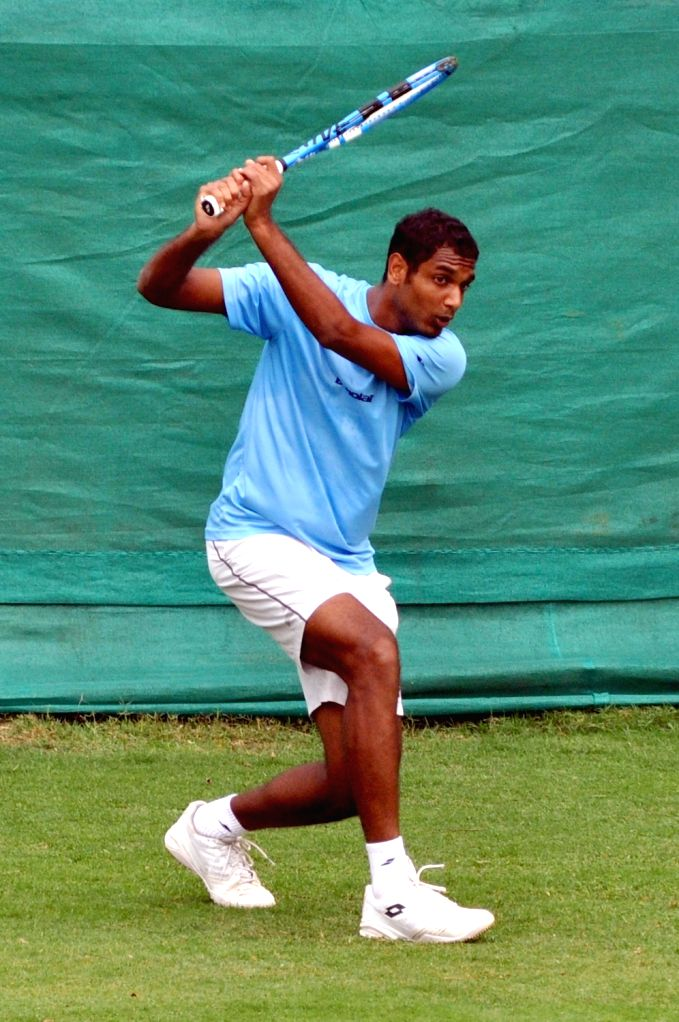 Indian tennis player Ramkumar Ramanathan in action during a practice session ahead of the Davis Cup World Group qualifier against Italy on February 1-2, in Kolkata, on Jan 28, 2019.