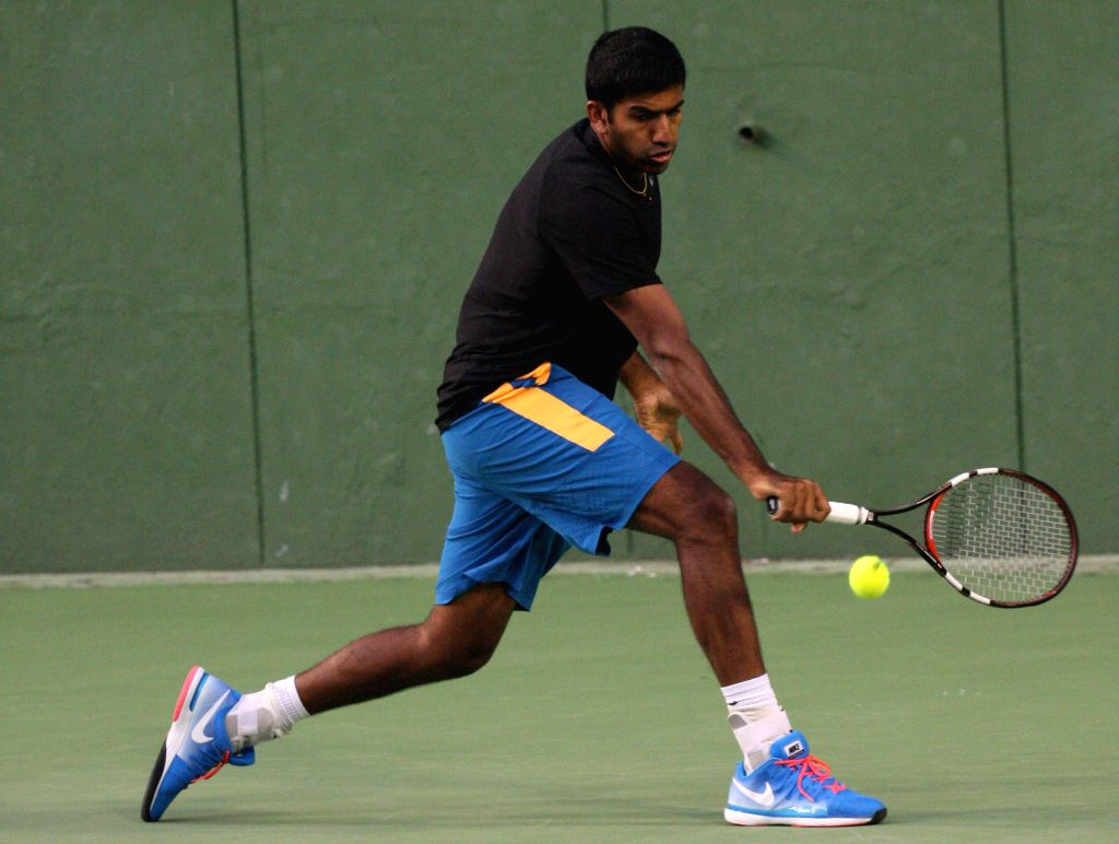 Indian tennis player Rohan Bopanna during a practice session ahead of Davis Cup 2014 in Bangalore on Sept 8, 2014. - Rohan Bopanna