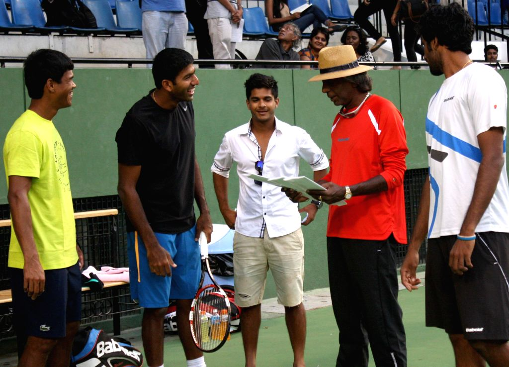 Indian tennis player Rohan Bopanna with tennis coach Vijay Amritraj during a practice session ahead of Davis Cup 2014 in Bangalore on Sept 8, 2014. - Rohan Bopanna