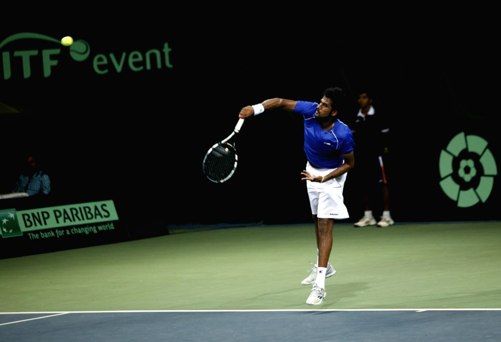 Indian tennis player Saketh Myneni in action against Spain's David Ferrer during Davis Cup World Group Play-off at RK Khanna Tennis Stadium in New Delhi on Sept 16, 2016. David Ferrer won.