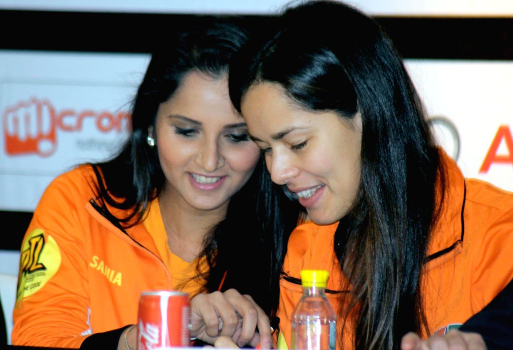 Indian tennis player Sania Mirza with her Serbian counterpart Ana Ivanovic during an International Premier Tennis League press conference in New Delhi, on Dec 5, 2014. - Sania Mirza