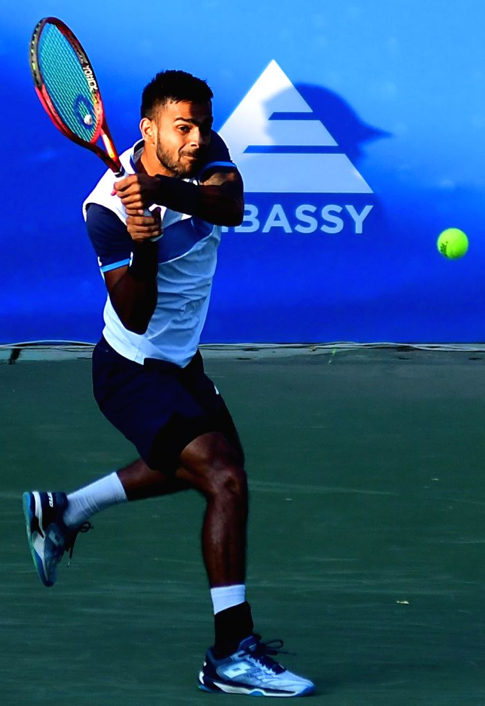 Indian tennis player Sumit Nagal in action against Malek Jaziri of Tunisia during the Bengaluru Open 2020 at Cubbon Park, in Bengaluru on Feb 11, 2020.
