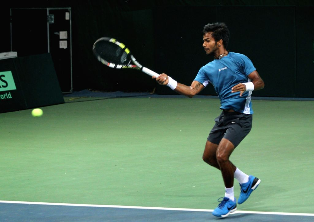 Indian tennis player Sumit Nagal in action during a practice session ahead of Davis Cup at DLTA in New Delhi on Sept 15, 2016.