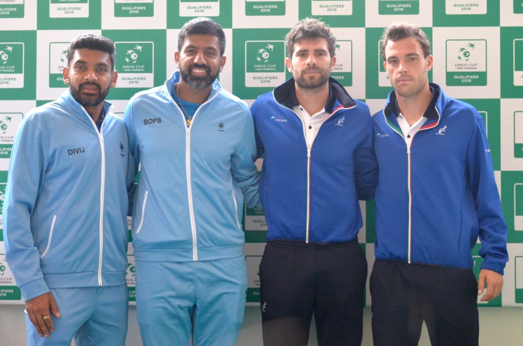Indian tennis players Divij Sharan, Rohan Bopanna with Italy's Marco Cecchinato and Simone Bolelli at the draw ceremony ahead of Davis Cup World Group qualifier between India and Italy on ... - Rohan Bopanna