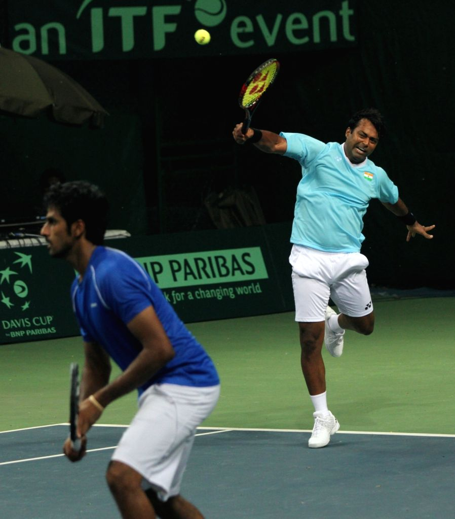 Indian tennis players Leander Paes and Saketh Myneni in action during Davis Cup World Group Play-off doubles match against Spain's Rafael Nadal and Marc Lopez at RK Khanna Tennis Stadium ...