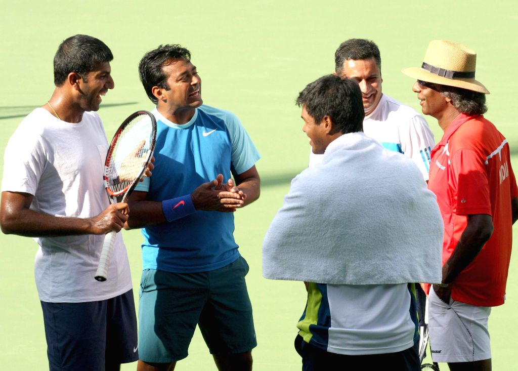 Indian tennis players Leander Paes, Somdev Devvarman and Rohan Bopanna with Indian tennis coach Vijay Amritraj during a practice session ahead of Davis Cup 2014 at KSLTA in Bangalore on Sept 9, 2014. - Rohan Bopanna