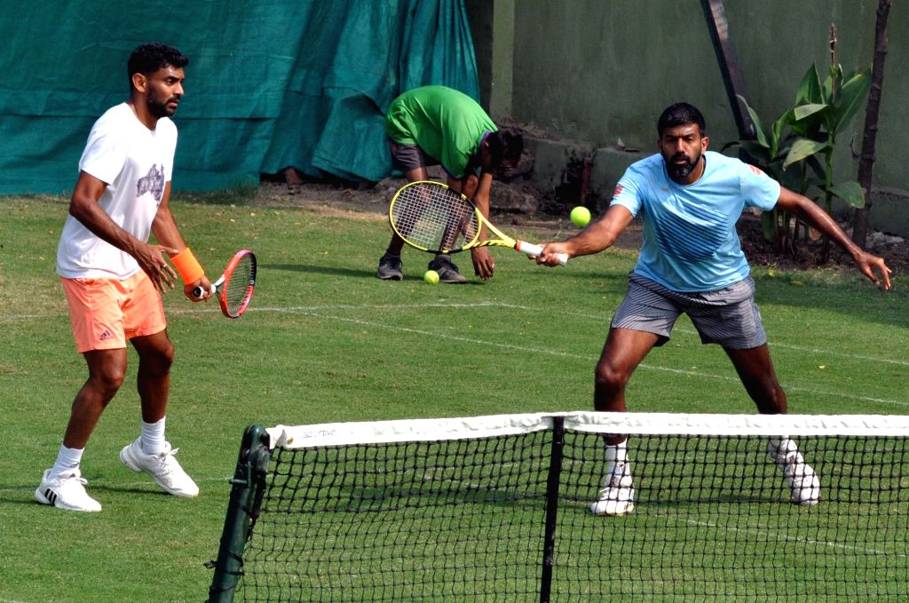 Indian tennis players Rohan Bopanna and Divij Sharan in action during a practice session ahead of the Davis Cup World Group qualifier against Italy on February 1-2, in Kolkata, on Jan 29, ... - Rohan Bopanna