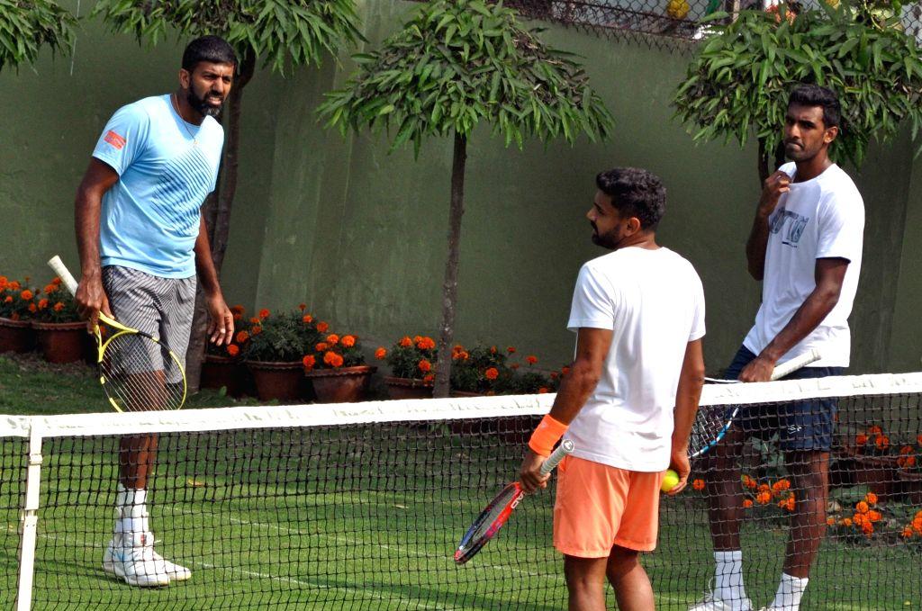 Indian tennis players Rohan Bopanna, Divij Sharan and Prajnesh Gunneswaran during a practice session ahead of the Davis Cup World Group qualifier against Italy on February 1-2, in Kolkata, ... - Rohan Bopanna