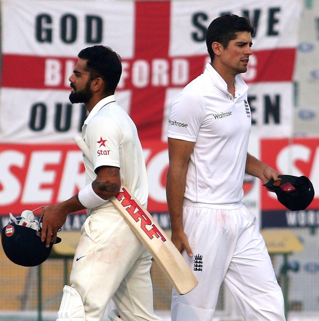 Indian Test cricket captain Virat Kohli and England's cricket captain Alastair Cook after end of the third test match at Punjab Cricket Association IS Bindra Stadium, Mohali on Nov 29, 2016. - Virat Kohli