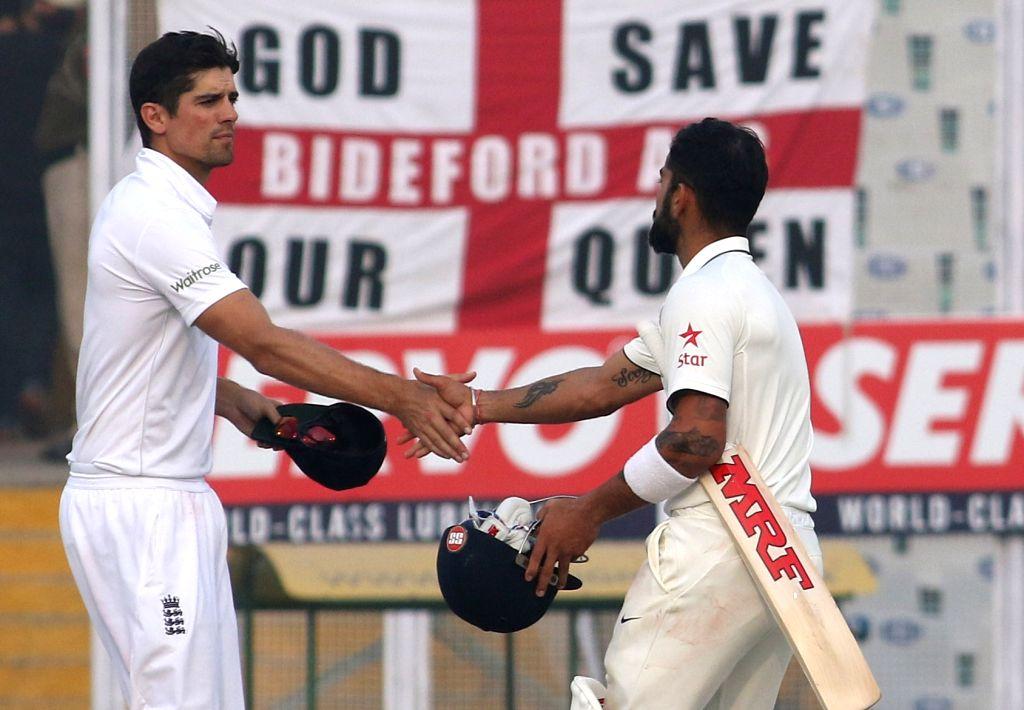 Indian Test cricket captain Virat Kohli shakes hand with England's cricket captain Alastair Cook after end of the third test match at Punjab Cricket Association IS Bindra Stadium, Mohali on ... - Virat Kohli