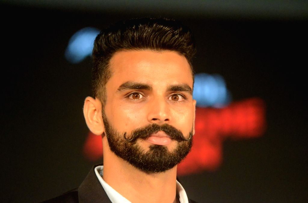 Indian triple jumper Arpinder Singh, who won gold in Asian Games 2018 at the launch of a male grooming range in Mumbai on Sept 18, 2018. - Arpinder Singh