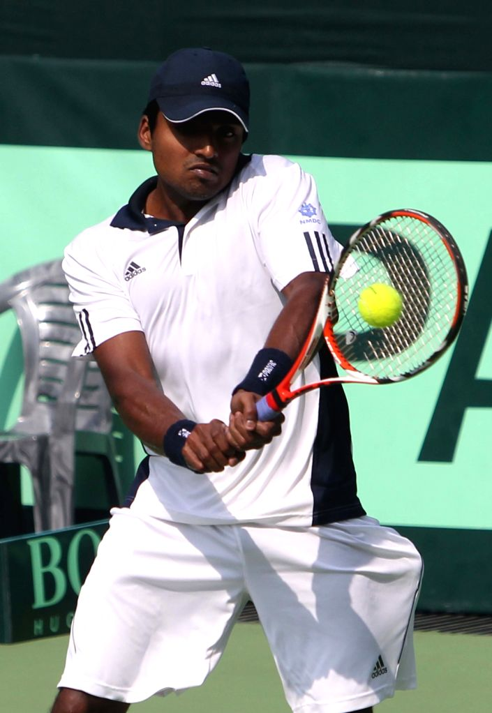 Indian Virali-Murugesan Ranjeet  plays a shot against South Korean tennis player Cho Min-Hyeok during the first singles match of the Davis Cup at the Delhi Lawn Tennis Association (DLTA) tennis ...