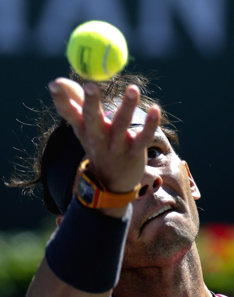INDIAN WELLS, March 14, 2019 - Rafael Nadal of Spain serves during the men's singles fourth round match against Filip Krajinovic of Serbia at the BNP Paribas Open tennis tournament in Indian Wells, ...