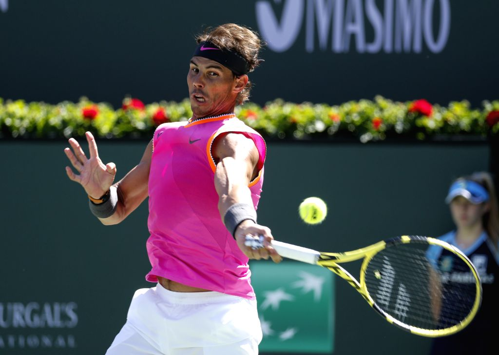 INDIAN WELLS, March 14, 2019 - Rafael Nadal of Spain returns the ball during the men's singles fourth round match against Filip Krajinovic of Serbia at the BNP Paribas Open tennis tournament in ...