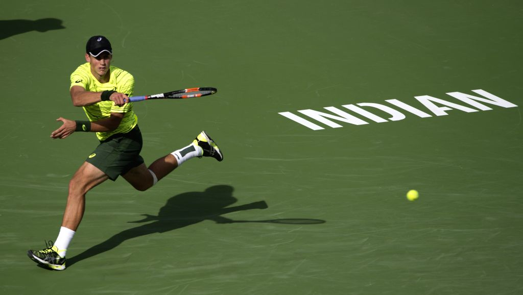 Canada's Vasek Pospisil returns a shot to Britain's Andy Murray during the men's singles second round match at the 2015 BNP Paribas Open at the Indian Wells ...