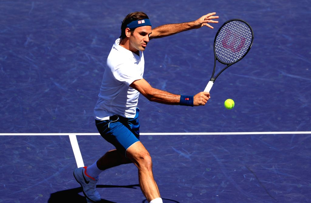 INDIAN WELLS, March 16, 2019 (Xinhua) -- Switzerland's Roger Federer hits a return during the men's singles quarterfinal match against Poland's Hubert Hurkacz at the BNP Paribas Open tennis tournament in Indian Wells, the United States, March 15, 201