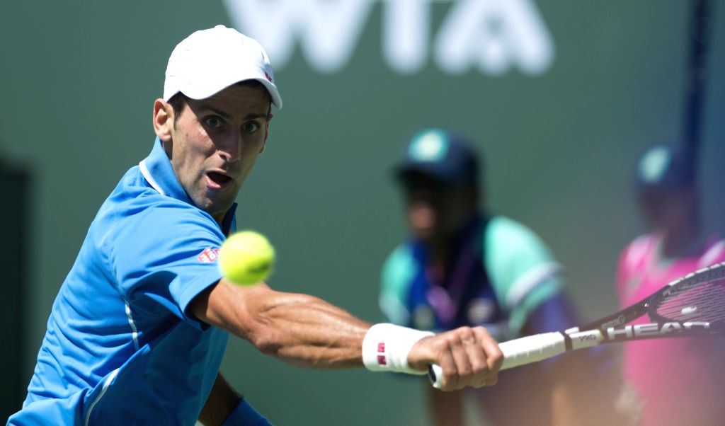 Novak Djokovic of Serbia returns the ball during the men's semifinal match against Andy Murray of Britain on the BNP Paribas Open tennis at the Indian Wells ...