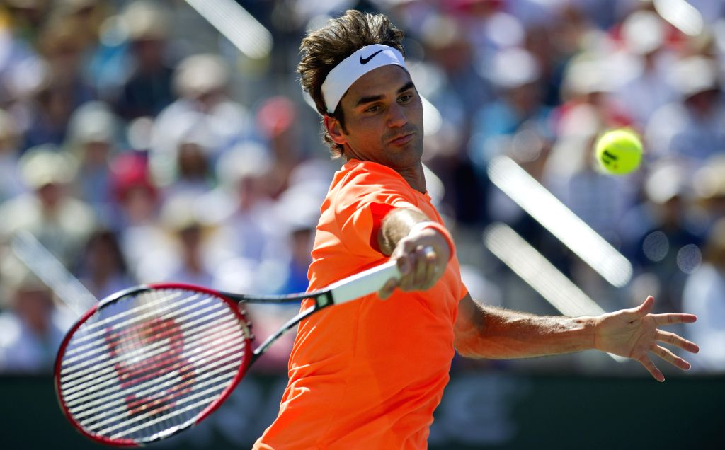 Roger Federer of Switzerland returns the ball during the men's semifinal match against Milos Raonic of Canada on the BNP Paribas Open tennis at the Indian ...
