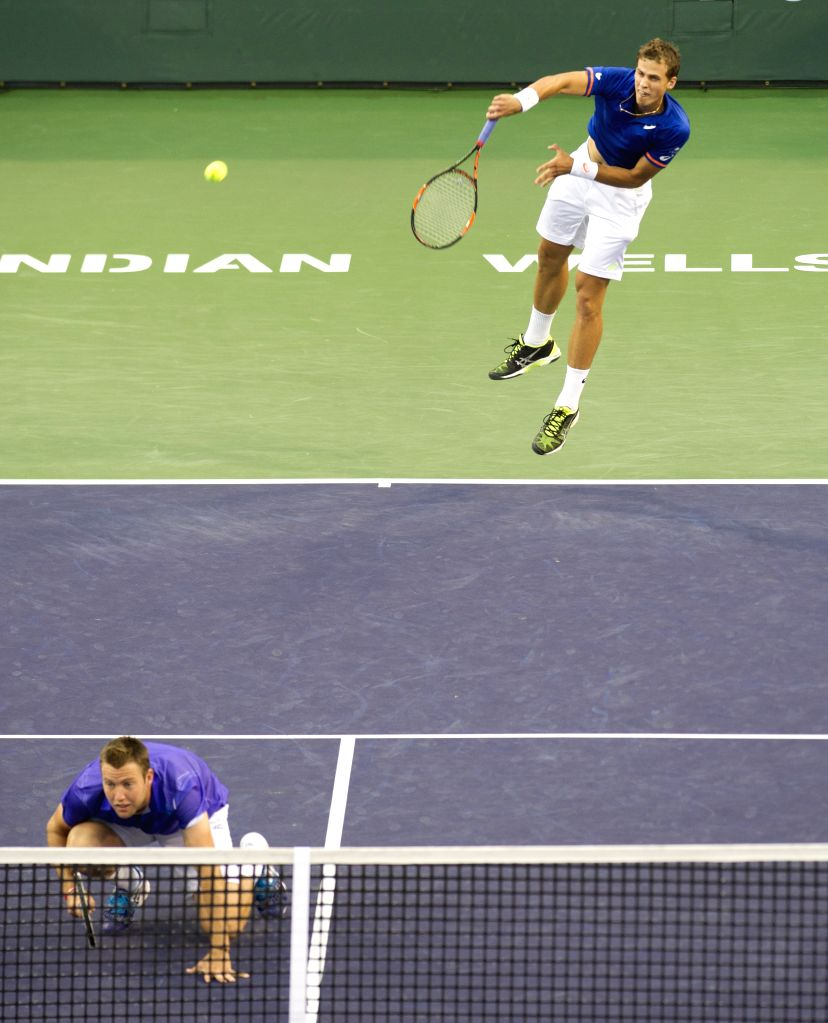 Vasek Pospisil (up) of Canada and Jack Sock of the United States compete during the men`s double final match against Italy`s Simone Bolelli and Fabio Fognini ...