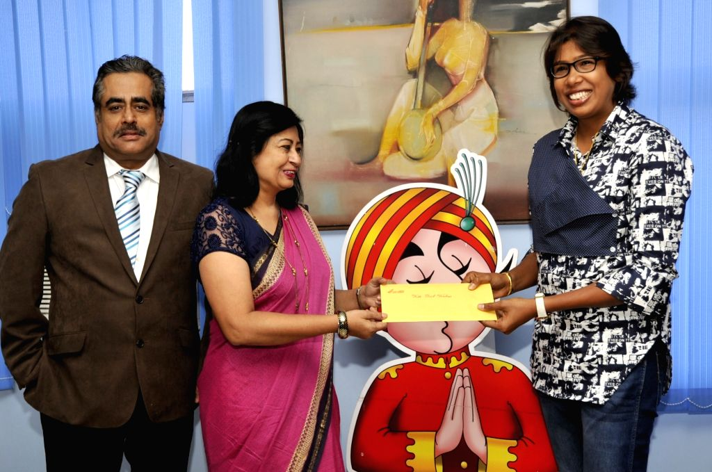 Indian woman cricketer Jhulan Goswami felicitated after being promoted to the post of manager at Air India in the presence of Air India regional director Rohit Bhasin in Kolkata on Aug 7, ... - Rohit Bhasin and Jhulan Goswami