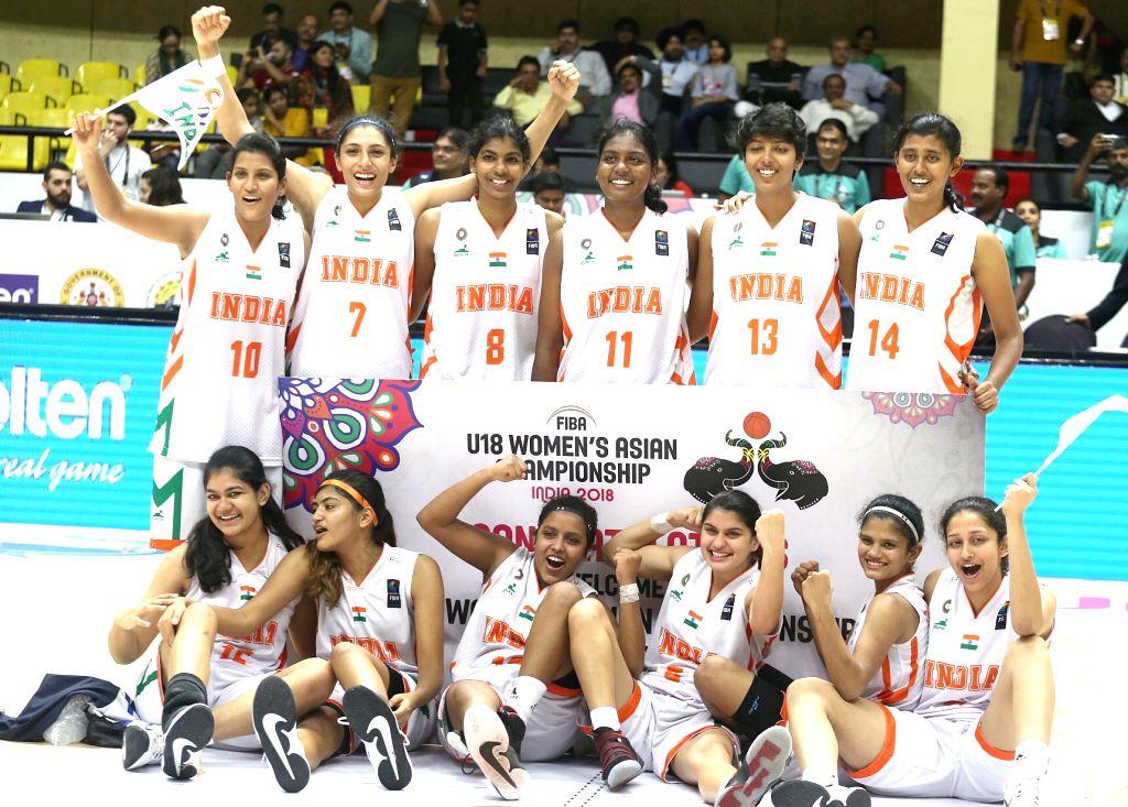Indian women basketball players celebrate after their win against Kazakhstan during the FIBA U18 Women's Asia Championship Division B Final match at Kanteerava Indoor Stadium, in Bengaluru ...