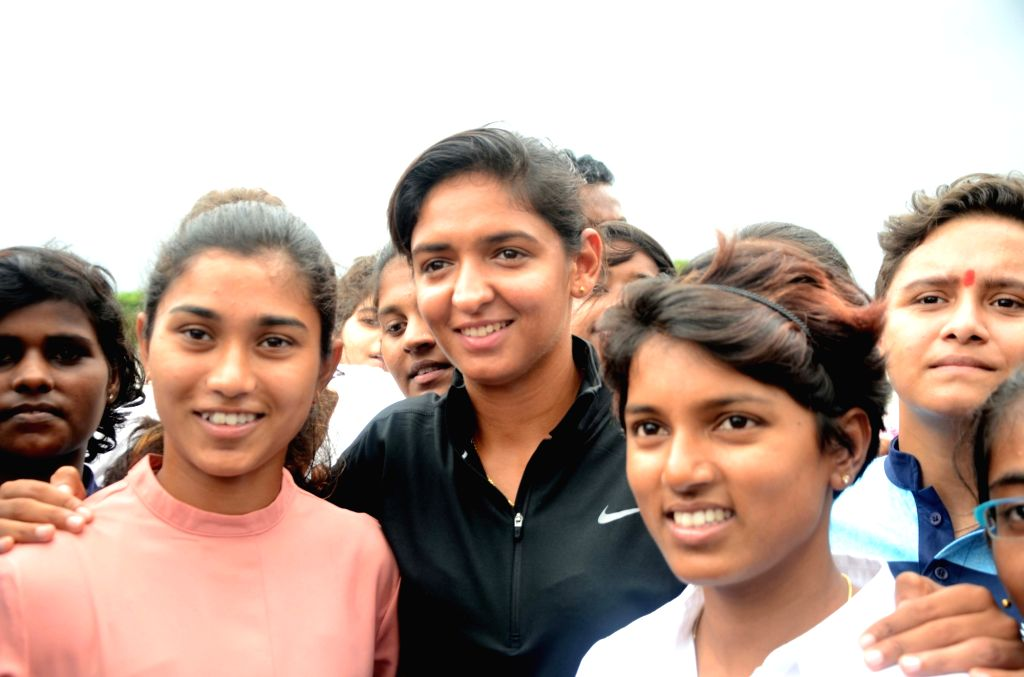 Indian women cricketer Poonam Raut along with teammates Harmanpreet Kaur and Nuzhat Parween during the launch of her cricket academy at Poisar Gymkhana, Kandivali in Mumbai on Sept 16, 2017. - Harmanpreet Kaur