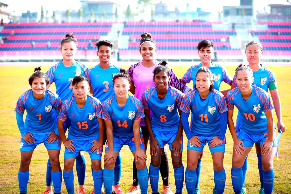 Indian women footballers pose for a group picture ahead of their football match against Sri Lanka during the 13th South Asian Games 2019 women at the Pokhara Stadium in Pokhara, Nepal on Dec ...