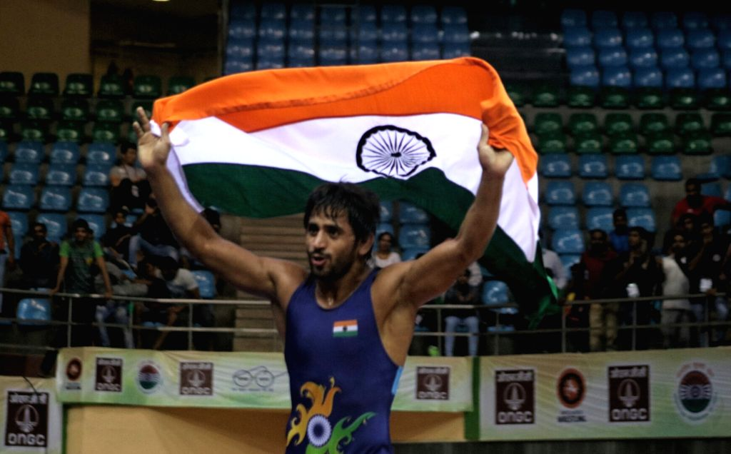Indian wrestler Bajrang Punia celebrates after winning a gold medal in men's 65kg freestyle wrestling at Asian Wrestling Championship in New Delhi, on May 13, 2017.