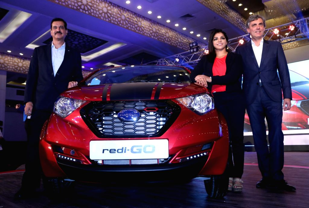 "Indian wrestler Sakshi Malik with Datsun India Vice President Jerome Saigot and Nissan Motor India Private Limited MD Arun Malhotra at the launch of ""redi-GO Sport"" in New Delhi, ... - Malik and Arun Malhotra"