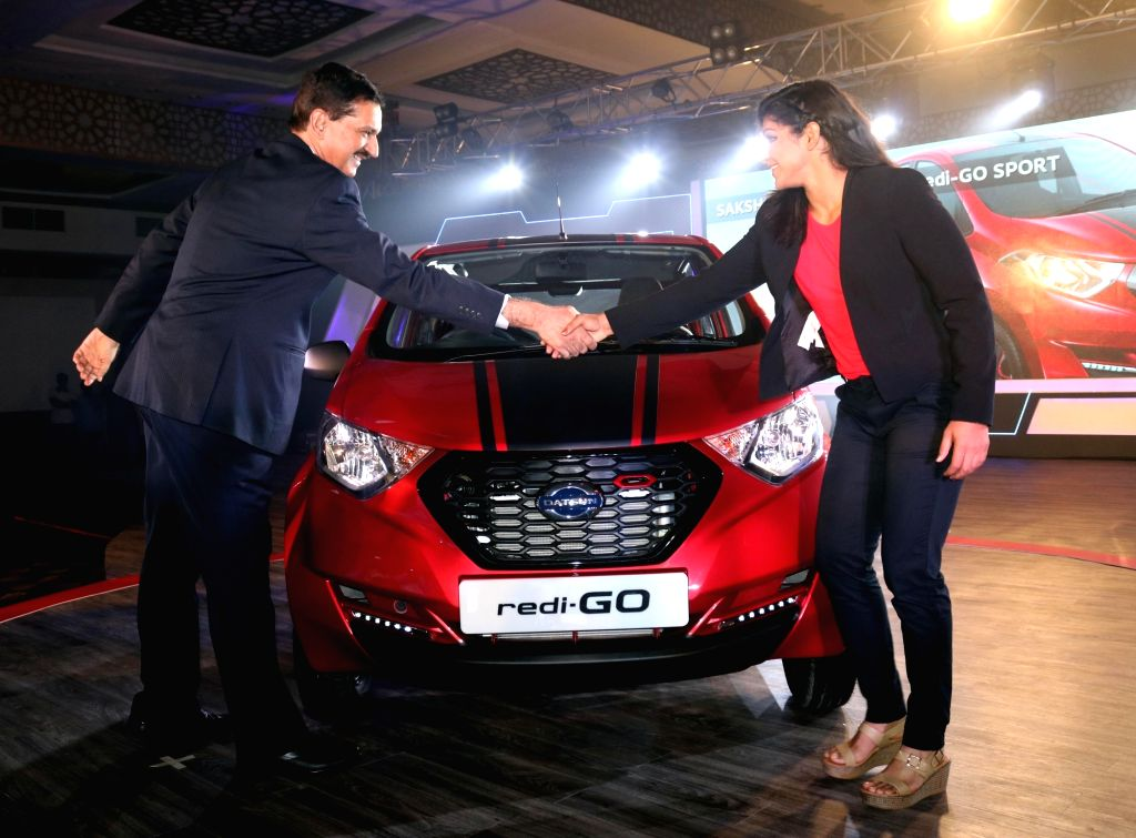 "Indian wrestler Sakshi Malik with Nissan Motor India Private Limited MD Arun Malhotra at the launch of ""redi-GO Sport"" in New Delhi, on Sept 29, 2016. - Malik and Arun Malhotra"