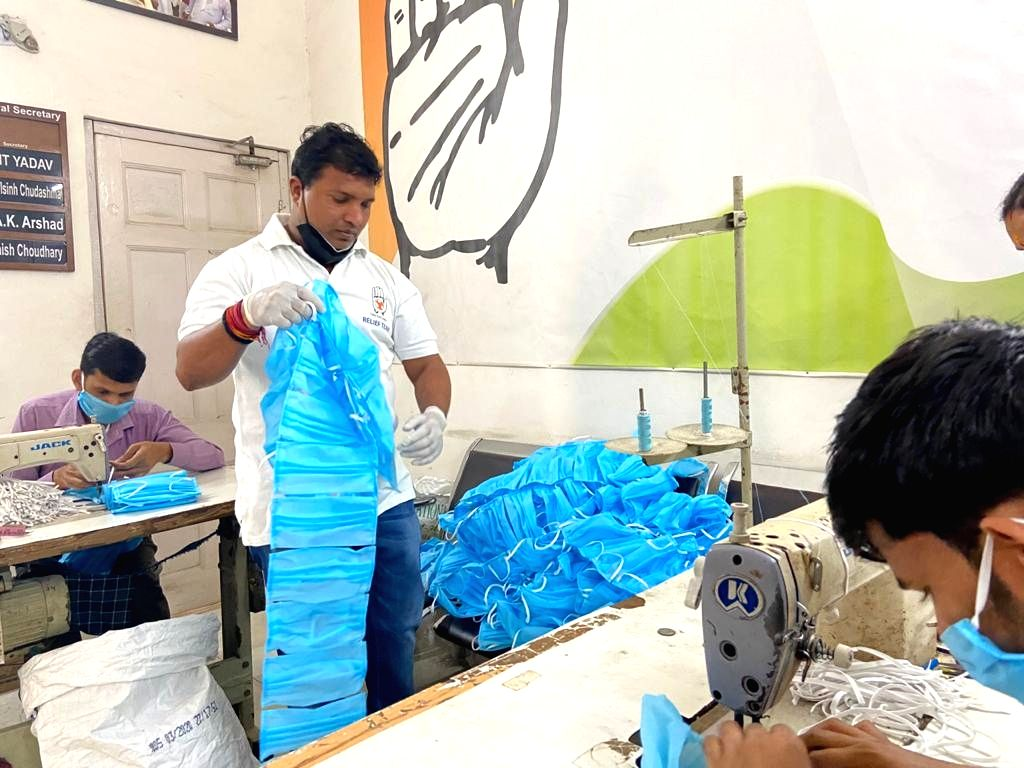 Indian Youth Congess (IYC) members busy making masks under the #MaskPehnoIndia initiative, wherein it aims to distribute masks to the underprivileged people of the country, who are not in ...