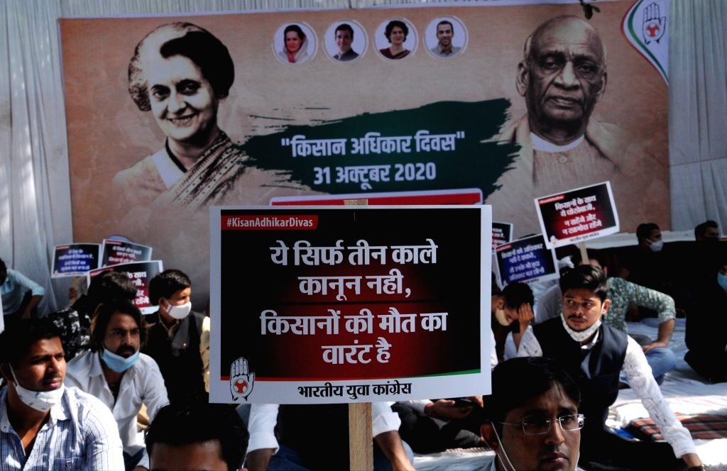Indian Youth Congress activists observe 'Kisaan Adhikar Diwas' on the occasion of the 36th death anniversary of Former Prime Minister of India Indira Gandhi and 145th birth anniversary of ... - Indira Gandhi and Sardar Vallabhbhai Patel