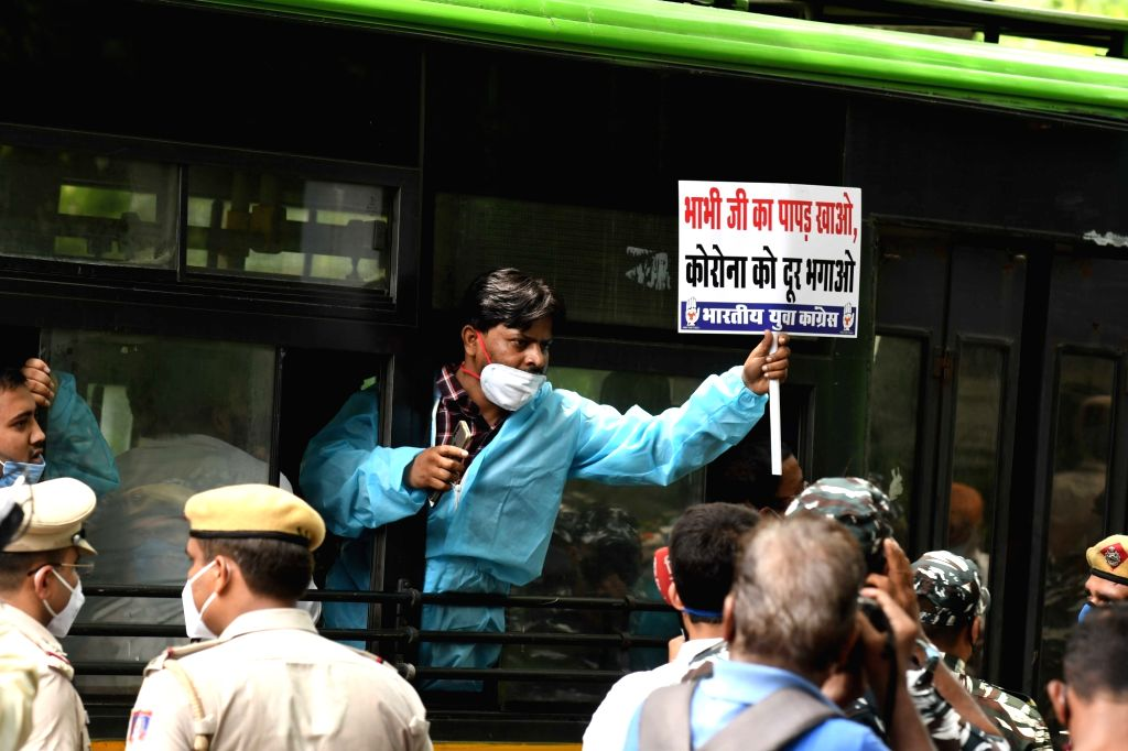 Indian Youth Congress (IYC) workers detained during their demonstration against the BJP-led Central Government over the rise in the number of COVID-19 cases mocking Minister of State Arjun ...