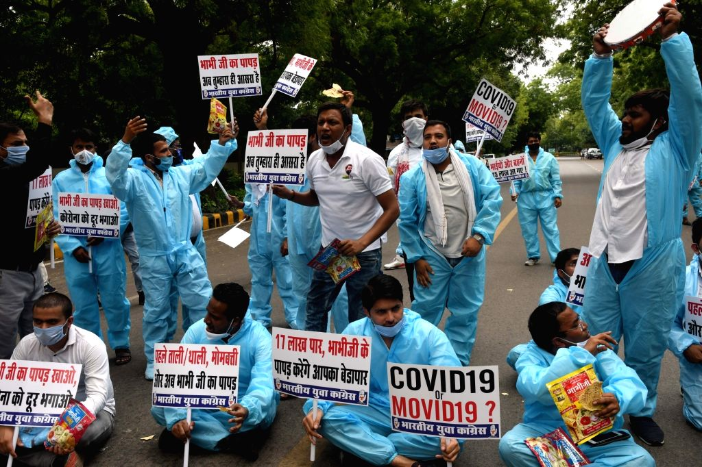 Indian Youth Congress (IYC) workers stage a demonstration against the BJP-led Central Government over the rise in the number of COVID-19 cases mocking Minister of State Arjun Ram Meghwal ...