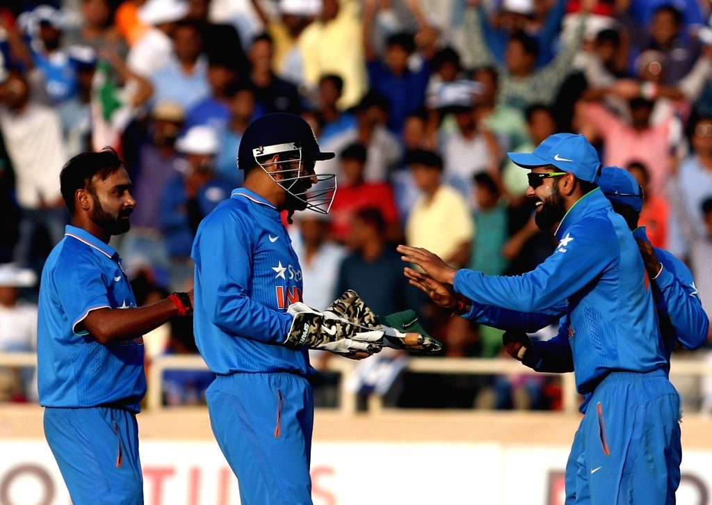 Indians celebrate fall of a wicket during the fourth ODI match between India and New Zealand at JSCA International Stadium Complex in Ranchi on Oct 26, 2016.