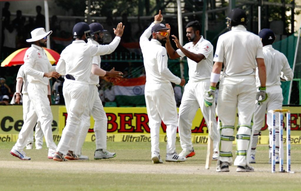 Indians celebrate fall of Martin Guptill's wicket on Day 4 of the 1st Test match between India and New Zealand at Green Park in Kanpur on Sept 25, 2016.