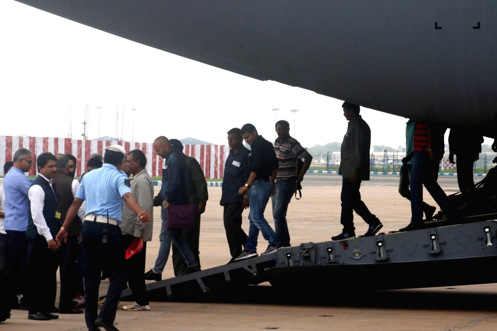 Indians evacuated from violence hit South Sudan, arrive at Palam Airport in New Delhi, on July 15, 2016. The evacuation was part of 'Operation Sankat Mochan' launched by the Indian ... - K. Singh