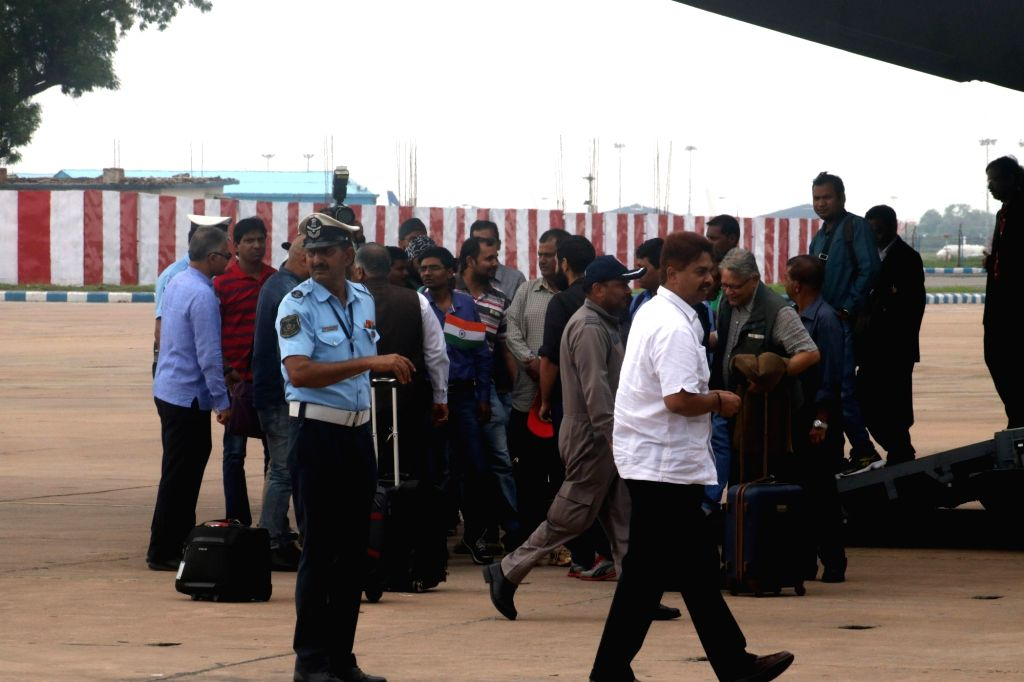 Indians evacuated from violence hit South Sudan arrive at Palam Airport in New Delhi, on July 15, 2016. The evacuation was part of 'Operation Sankat Mochan' launched by the Indian ... - K. Singh