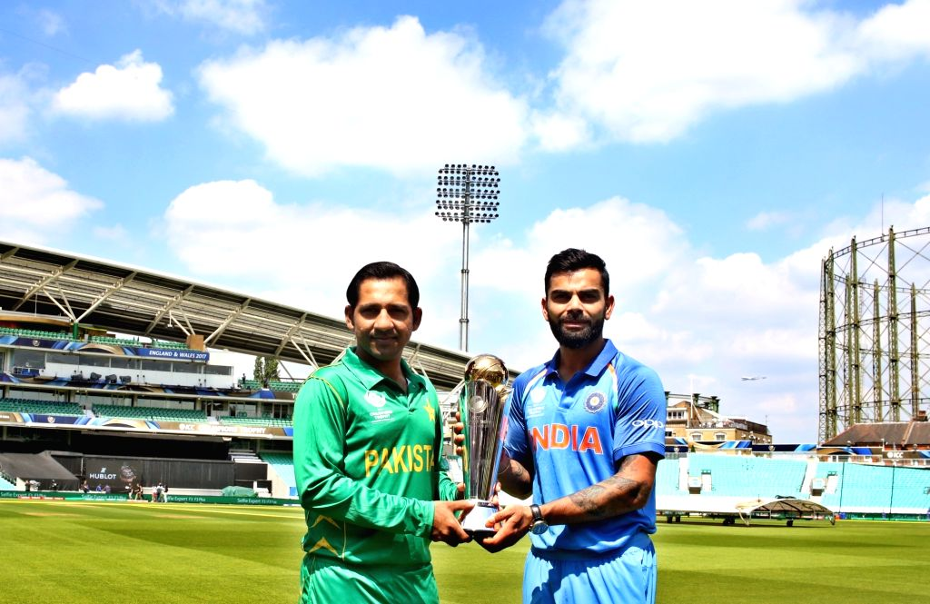 Indias skipper Virat Kohli (L) and Pakistans skipper Sarfraz Ahmed (R) pose with the ICC Champions Trophy on the eve of tournaments final match between India and Pakistan at the Oval in ... - Virat Kohli and Surjeet Yadav