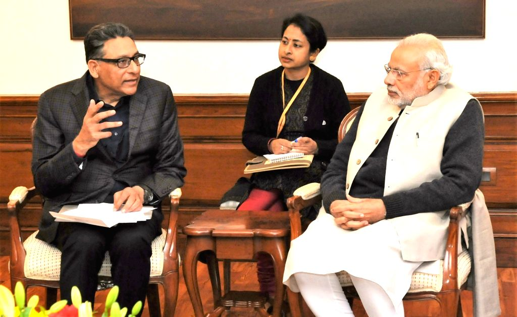 Indo US Venture Partners Founder & MD Vinod Dham calls on the Prime Minister Narendra Modi, in New Delhi, on Jan 16, 2016. - Narendra Modi