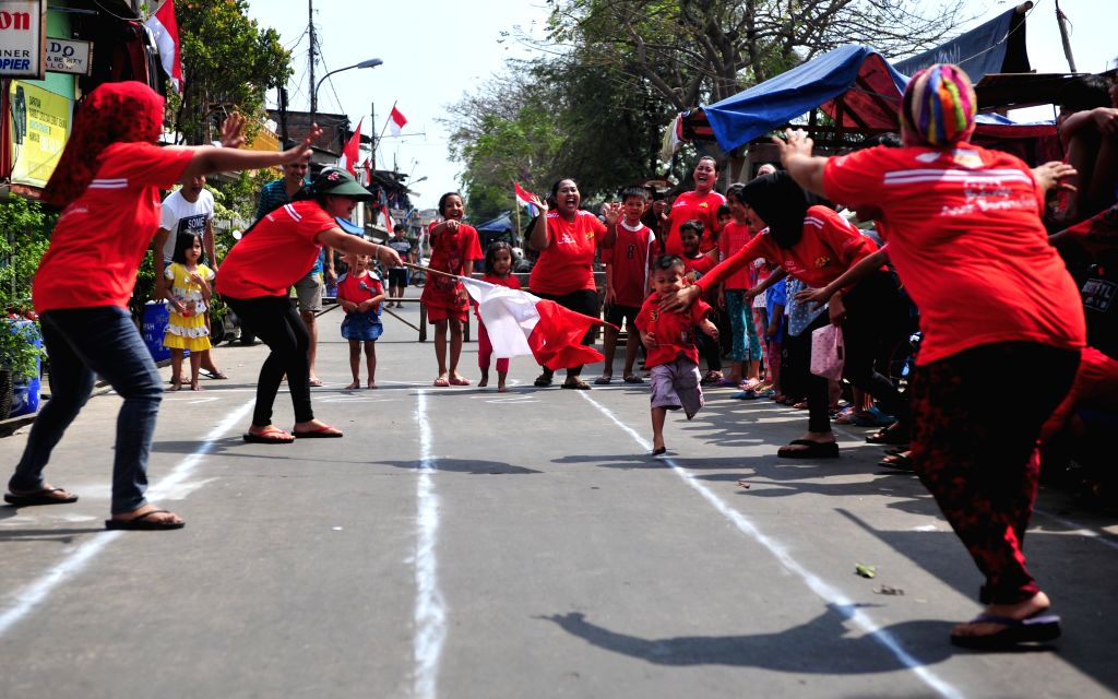 Indonesian children compete in a game at a celebration marking Indonesia's 70th Independence Day in Jakarta, Indonesia, Aug. 17, 2015.