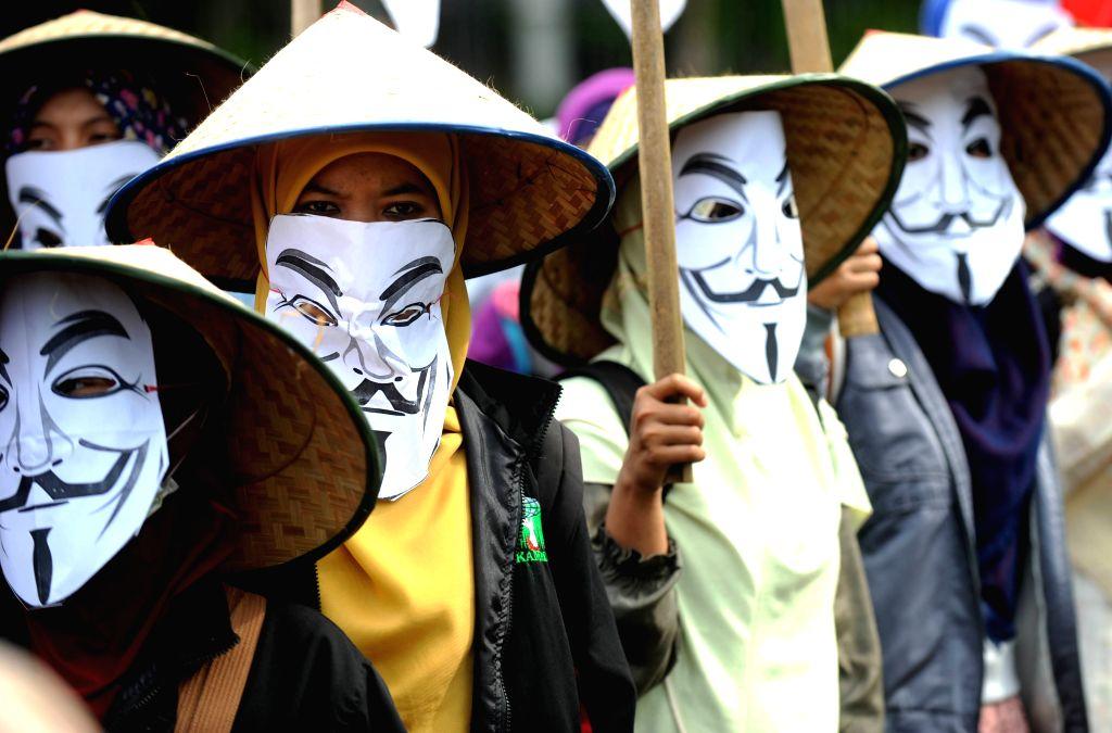 Indonesian Muslim students attend a rally against Freeport Indonesia allegations in Jakarta, Indonesia, Dec. 7, 2015. Indonesia's House of Representative speaker ... - Setya Novanto