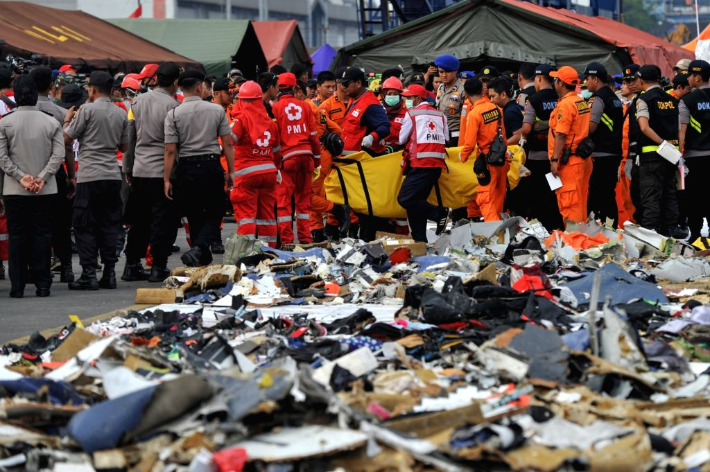 : Indonesian Search and Rescue (SAR) members carry a body bag that contains victim of the crashed Lion Air JT 610 to ambulance, at the Tanjung Priok port, Jakarta, ...