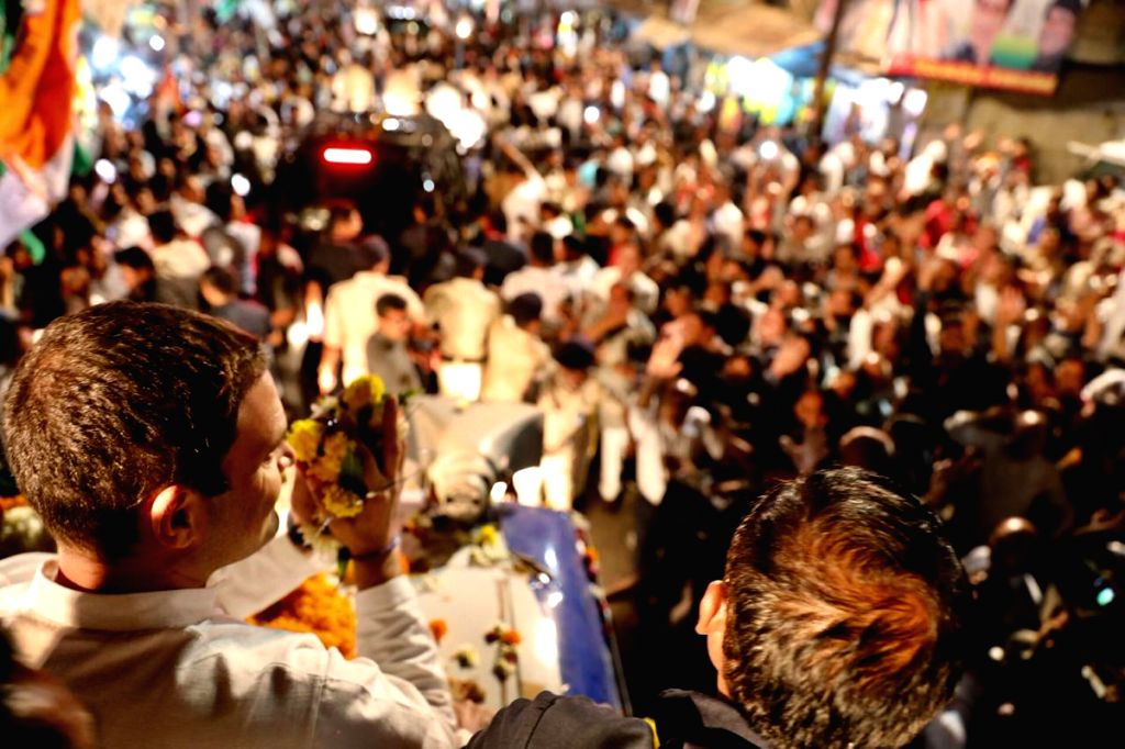 :Indore: Congress President Rahul Gandhi during a roadshow in Indore, Madhya Pradesh on Oct 29, 2018. (Photo: IANS/Congress).