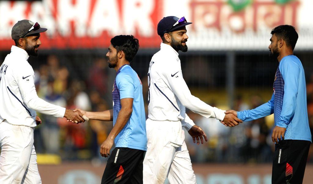 Indore: India's Ajinkya Rahane and Virat Kohli being congratulated by Bangladesh players after India won by 130 runs against Bangladesh in the first Test of the two-match series at Holkar Cricket Stadium in Indore, Madhya Pradesh on Nov 16, 2019. (Ph - Virat Kohli and Surjeet Yadav