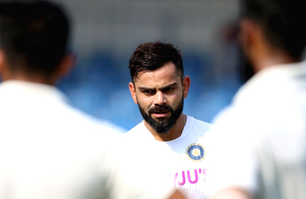 Indore: Indian skipper Virat Kohli during a practice session ahead of the 1st Test match against Bangladesh, at Holkar Cricket Stadium in Indore, Madhya Pradesh on Nov 12, 2019. (Photo: Surjeet Yadav/IANS) - Virat Kohli and Surjeet Yadav