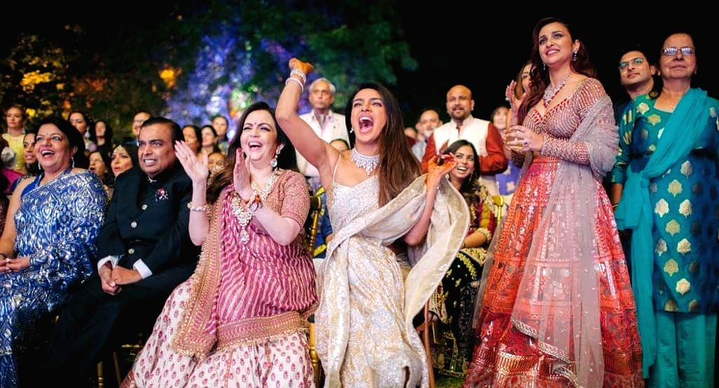 Industrialist Mukesh Ambani and his wife Nita Ambani with actresses Priyanka Chopra and Parineeti Chopra at Priyanka's wedding with American singer Nick Jonas in Jodhpur on Dec 2, 2018. - Priyanka Chopra, Parineeti Chopra, Mukesh Ambani and Nita Ambani