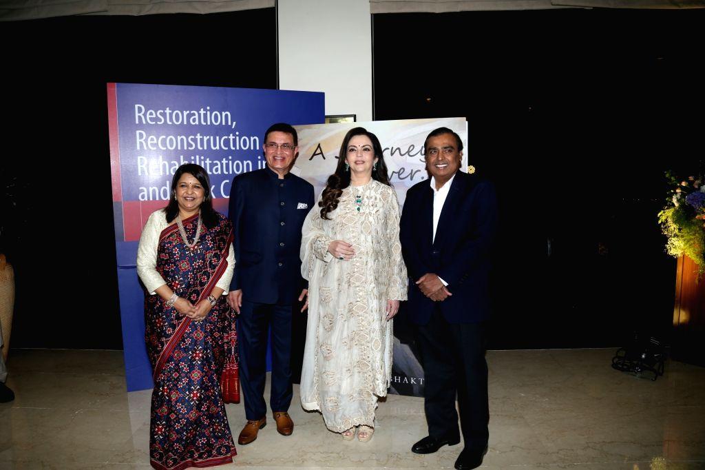 Industrialist Mukesh Ambani and his wife Nita Ambani at the book launch on Dr Vijay Haribhakti in Mumbai, on Aug 31, 2019. - Mukesh Ambani and Nita Ambani